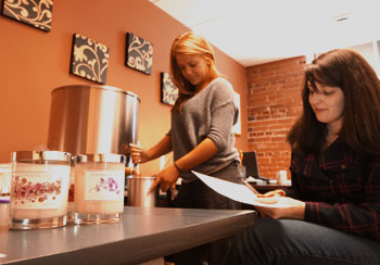 Crime Victim Advocacy Center staff work on holiday Consolare candles right in the organization's office.