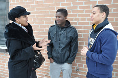Fathers' Support Center Youth Mentor Michelle Hiner talks with two mentees about an upcoming college tour the three will take.