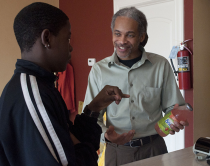 Juice Box owner/operator Shawn Mckie talks with local teenager Terrell about making healthy food choices. ARCHS serves as the fiscal agent for JUICE, Inc., which is a collaboration with Juice Box to form the nationally renowned Juice Project.
